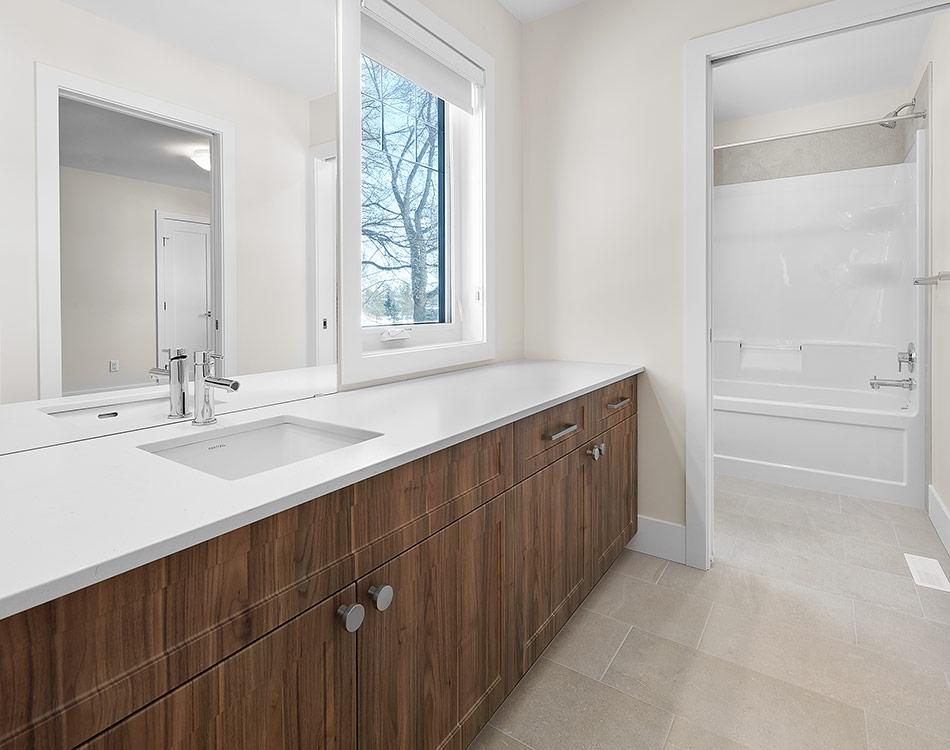 walnut cabinets in bathroom