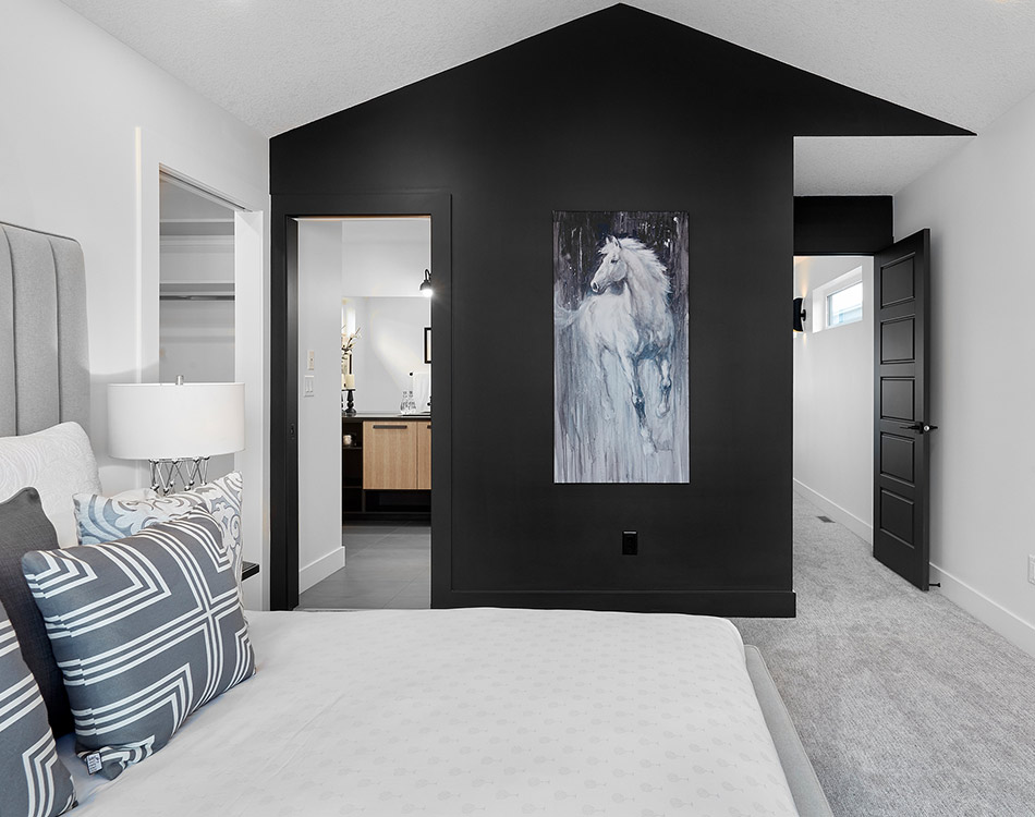 master bedroom with black wall